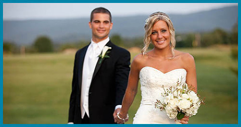 Bride and Groom in front of a mountain view at Bowling Green Country Club in Front Royal Virginia
